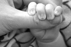 B&W baby holding hand